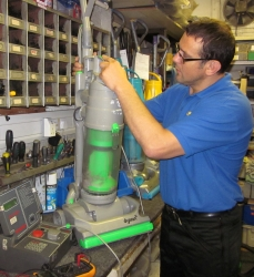 member of Barlows staff servicing a vacuum