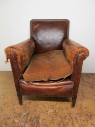 Old Antique worn out leather chair made to look fantastic again