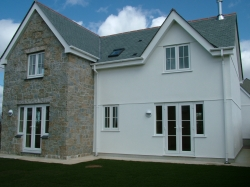 New build , cavity blockwork with Cowley stone facing .