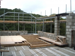 Lounge partly built , steel frame up ready for roof