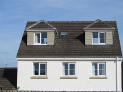 New roof fitted , formed 2 bedrooms and bathroom , roof concrete tile , dormers clad with hardiplank boards .