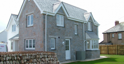 Property constructed of cavity blockwork and Cowley granite facings .