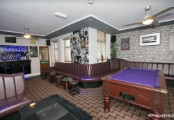 Bar Seating Area With Pool Table and other games ~ Photo Property of www.oyster.com.
