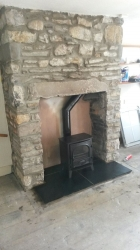 Wood Burner in Fireplace