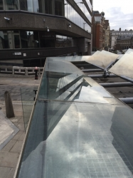 A few metres from the Monument to the Fire of London is its security hut and toilet block. We clean the glass to it for Servest and the City of London Corporation