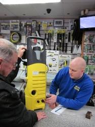 Customer service at BArlows diagnosing issue with vacuum showing customer