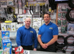 Two workers at Barlow's behind service desk