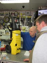 Member of staff at Barlow's diagnosing Karcher vacuum