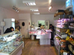 Inside of Little Town Farm Shop, showing ice cream stand