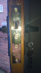 This is a Mortice lock commonly found on wooden doors, always look for a British Standard 5 lever mortice lock to comply with insurance requirements.