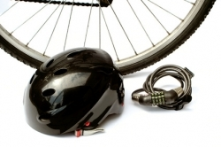 a helmet and lock in front of bike wheel