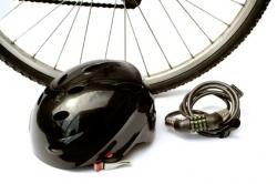 a helmet and lock in front of bike wheel