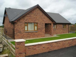 This is a 3 bedroom bungalow with a sun room to the rear