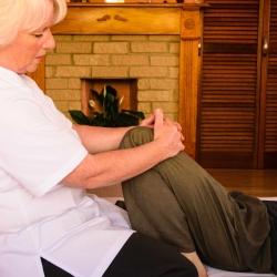 Sally Legg performing Reki on a patients leg