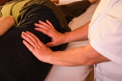 Sally Legg performing Reiki on one patients back