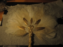 The Bride carried this in place of a bouquet. The feathers were dyed to match the bridesmaids dresses and the Art deco colour scheme for the wedding. A practical and beautiful accessory for any Bride! From £65