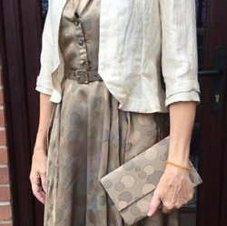 Simple but elegant outfit, complete with matching handbag and belt. from £400