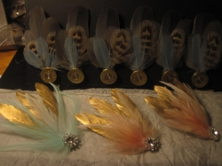 These feathery headpieces and buttonholes were made for the wedding party. The buttonholes followed the countryside theme, based on shotgun cartridges and pheasant feathers and the Bridesmaids accessories matched the Brides headpiece and fan. Feathery hair clips fro £6 each, Buttonholes from £4 each