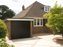 Space saving roll up garage doors