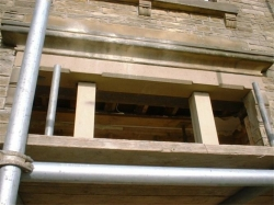 A reinforced concrete stone faced lintel was made and lifted into place to support the outer leaf and a steel beam inserted to support the inner leaf, using 2 lintels meant it was possible to lift them into place by hand