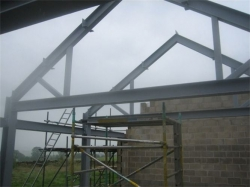 to provide a totally clear internal area and provision for a future first floor / storage area.