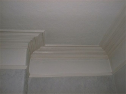 Together with redecoration the ornate coving had to be matched at each side of the opening