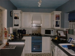 the family had their kitchen backI'm sure you'll agree it looks a in a lot better condition than the picture above.