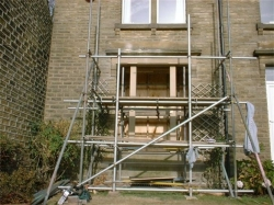 The scaffold had to be capable of supporting the front elevation whilst the lintel was changed and also to be used as a working platform, the old lintel was lowered onto rollers on the scaffold and slid out, it then had to be cut into smaller pieces to enable it to be manhandled to ground level.