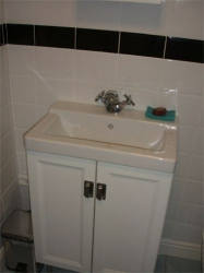 There is also a full size bath and shower