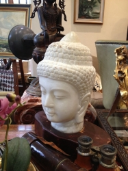 Carved marble head of Buddha