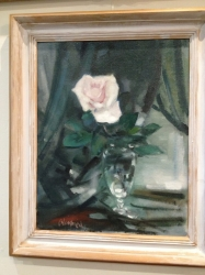 Oil on board of a rose in a vase by Edmund Blampied