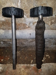 This shows the magnets part way through a powerflush. The left one has been cleaned, the right shows just how much sludge and debris can build up if the system isn't properly looked after.