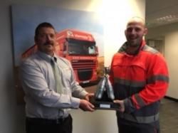 Peter Jarratt holding an award from Coca Cola