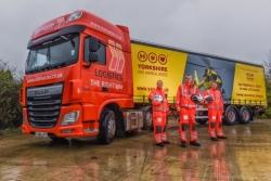 air ambulance sponsored orange logistics truck