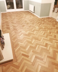 LVT-TLC blushed oak parquet with TLC Massimo invent English oak as boarder.