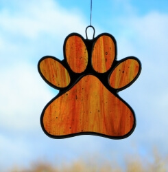 Stained Glass Window Suncatcher (Paw Print) in red and amber glass