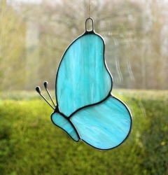 Stained Glass suncatcher (Butterfly) in sky blue and white streaky glass
