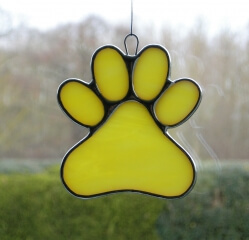 Stained Glass Window Suncatcher (Paw Print) in yellow and white glass