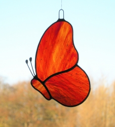 Stained Glass suncatcher (Butterfly) in orange and red glass