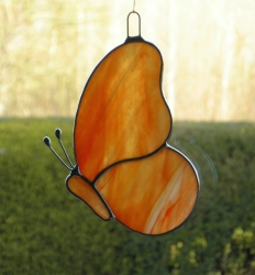 Stained Glass suncatcher (Butterfly) in orange and red opalescent glass