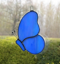 Stained Glass suncatcher (Butterfly) in blue iridescent opalescent glass
