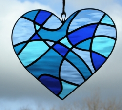 Stained Glass suncatcher Abstract Love Heart in four shades of blue rippling waterglass