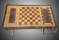 Veneered satinwood games table  Satinwood & rosewood games table with inlayed black & white lines  Chess board & cribbage.