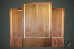 Crown cut american walnut wit a maple outter line and boxwood detailing to the center panel.