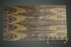 Santos rosewood with an inset satinwood line.