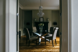 Striking chandelier centred over a dining table