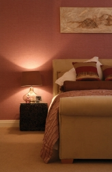 Low bedside lamp for atmosphere. Reading light required
