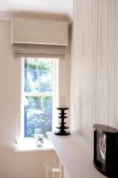 Velvet upholstered pelmet and moire silk roman blind creates textural interest