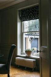 Discreet blind to enhance architectural features