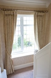 The contemporary metallic pole gives a fresh perspective to curtains in a classic design, paired with matching paper.